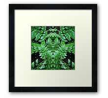 Fern with green man face hidden Framed Print