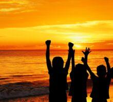 Children silhouettes on a  sunset beach Sticker