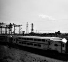 On a train, passing another. by ShellyKay
