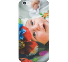 Newborn child relaxing in bed. iPhone Case/Skin