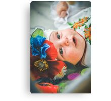 Newborn child relaxing in bed. Canvas Print