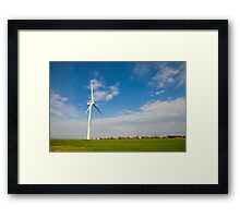 Wind turbines create clean and renewable electricity  Framed Print