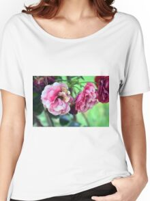Beautiful delicate pink roses on green leaves background. Women's Relaxed Fit T-Shirt
