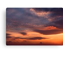 Sunset sky with orange clouds. Canvas Print