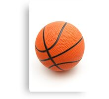 Bright orange basketball ball on a white background Canvas Print