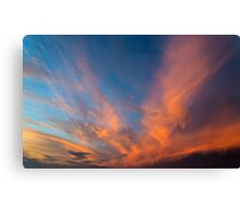 Sky with orange clouds. Canvas Print