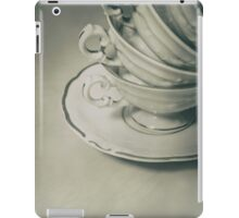 Four teacups and the small plate on the table iPad Case/Skin