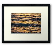 Sea surface at sunset. Framed Print