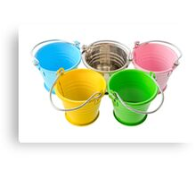 Five colorful buckets, arranged as a symbol of Olympic Games, isolated on white background Canvas Print