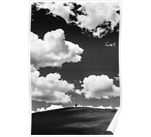 A lone tree under a heavy white cloud in black and white Poster