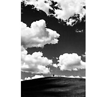 A lone tree under a heavy white cloud in black and white Photographic Print