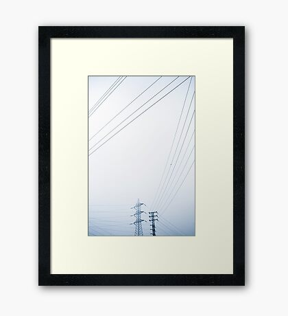 Two high voltage towers in the haze Framed Print
