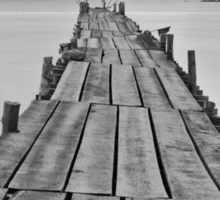 Black and white photography of a beach wooden pier Sticker