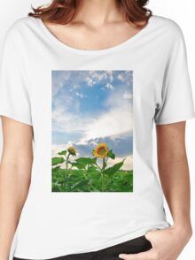 View of field with blooming sunflowers with sunset in background Women's Relaxed Fit T-Shirt