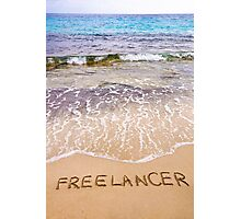 Word FREELANCER written in sand, on a beautiful beach Photographic Print