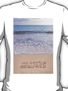 No office required written on sand, blue ocean water in background T-Shirt