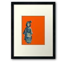 little girl in blue Framed Print