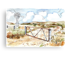 A windpomp and a gate Canvas Print