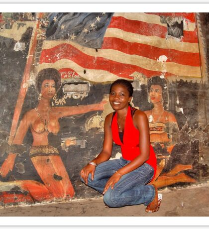 African Girl in front of a Graffiti of Black gils and US Flag Sticker