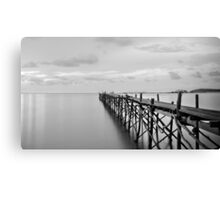 Black and white photography of a beach wooden pier Canvas Print