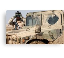 Soldier watching with Hummer Canvas Print