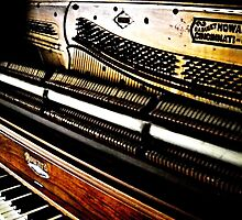 antique piano by JComstock