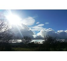 Sunshine breaking through the clouds Photographic Print