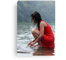woman wearing a red dress sitting on the edge of the river Canvas Print