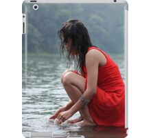 woman wearing a red dress sitting on the edge of the river iPad Case/Skin