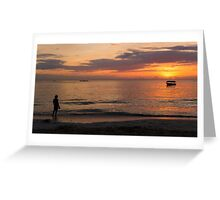 Woman watching the sunset on the beach Greeting Card