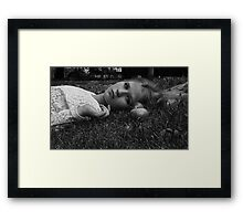 girl laying in grass  Framed Print