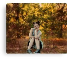 Girl sitting in the garden in autumn Canvas Print