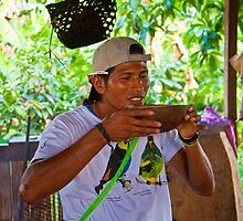 Ecuador. Jungle. Our Local Guide drinking Chicha. by vadim19