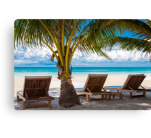 Sunbeds on exotic tropical palm beach Canvas Print