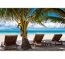 Sunbeds on exotic tropical palm beach Photographic Print