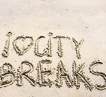 I Love City Breaks message written on sand by Stanciuc