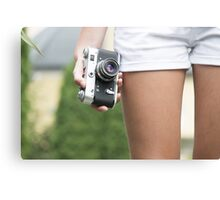 Woman with retro camera Canvas Print