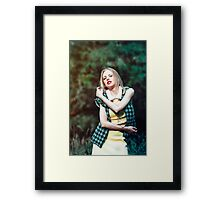 Portrait of a beautiful woman with a braid and flower on natural background Framed Print