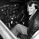Amelia Earhart Sitting In Airplane Cockpit by warishellstore