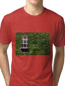 Window on leafy Cotswolds house facade, UK Tri-blend T-Shirt