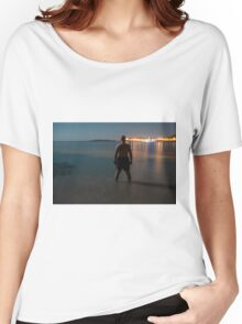 Man in sea watching the view at night Women's Relaxed Fit T-Shirt