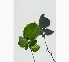 Sophisticated Shadows - Glossy Hazelnut Leaves on White Stucco - Vertical View Upwards Right Unisex T-Shirt
