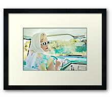 Blonde woman drive the car Framed Print