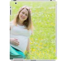 Pregnant woman in the park iPad Case/Skin