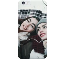 Friends are playing on the ground in the snow iPhone Case/Skin