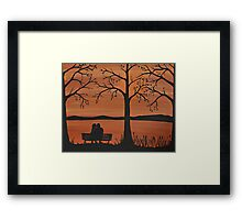 Couple sitting on a bench Framed Print