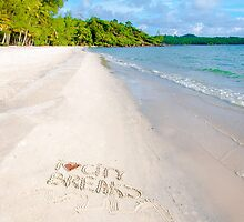 I Love City Breaks message written on sand, vacation concept by Stanciuc