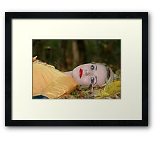 woman lying on the grass in autumn  Framed Print