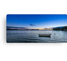 Sunset with boat moored Canvas Print