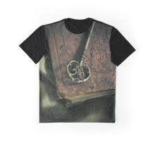 Brass ornamented key on old brown book Graphic T-Shirt